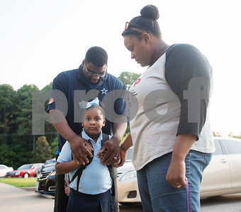 Davarye and Frednisha Jackson pray over their daughter Taraji Jackson, 4, before entering Promise Academy for first day of school on Thursday Aug. 23, 2018. The school has a new location inside the Boys and Girls Club building, 504 W. 32nd Street.  (Sarah A. Miller/Tyler Morning Telegraph)