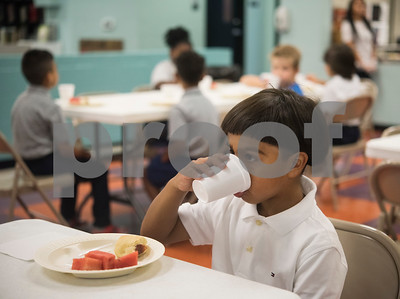 Adrian Uribe, 6, eats breakfast before classes begin at Promise Academy, a private Christian school in Tyler on the first day of school on Thursday Aug. 23, 2018. The school has a new location inside the Boys and Girls Club building, 504 W. 32nd Street.  (Sarah A. Miller/Tyler Morning Telegraph)