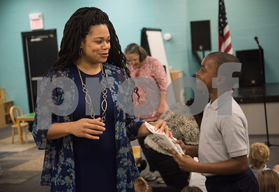 Second grade teacher Gloria Johnson talks with her on the first day of school at Promise Academy, a private Christian school in Tyler for the first day of school on Thursday Aug. 23, 2018. The school has a new location inside the Boys and Girls Club building, 504 W. 32nd Street.  (Sarah A. Miller/Tyler Morning Telegraph)