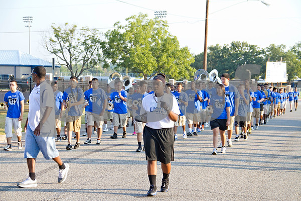 Photo by Shannon Wilson / Tyler Morning Telegraph The John Tyler High School Big Blue Band perfoms their first march-a-thon event by marching through the streets of the Pine Brook neighborhood on Saturday morning.