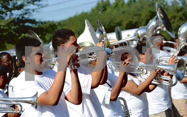 The brass section of the band contributes to the melody. (Victor Texcucano/Staff)