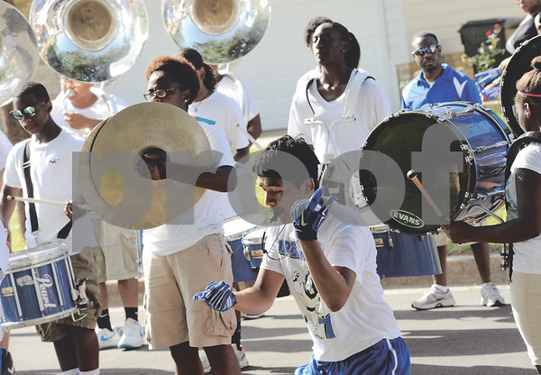 The John Tyler High School marching band makes its presence known at neighborhoods surrounding the school during the March-a-Thon on Saturday morning. The students marched around the streets playing music while gathering donations from community members. (Victor Texcucano/Staff)