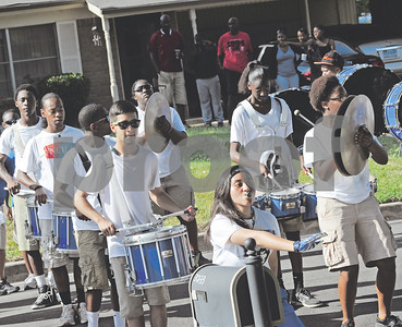 Community members gather outside their homes as the band plays on. (Victor Texcucano/Staff)