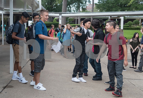 Students talk in the morning before school on the first day of classes at Robert E. Lee High School in Tyler Monday Aug. 28, 2017.  (Sarah A. Miller/Tyler Morning Telegraph)