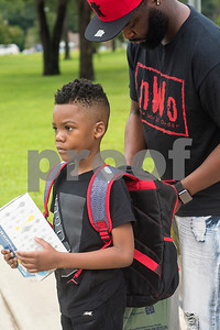 Jakaiden Fraction, 6, holds a box of tissues as Dalfie Fraction zips up Jakaiden's backpack during the first day of school at Orr Elementary School in Tyler, Texas, on Monday, Aug. 28, 2017. (Chelsea Purgahn/Tyler Morning Telegraph)