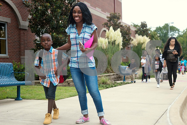 Christian Tennyson, 5, and Shalunda Bell pose for a photo during the first day of school at Orr Elementary School in Tyler, Texas, on Monday, Aug. 28, 2017. (Chelsea Purgahn/Tyler Morning Telegraph)