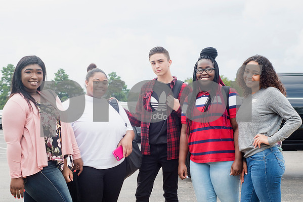 Juniors Versailles Criss, Shariah Walters, Gerardo Urbina, Elesha Taylor and senior Debraciana Sash pose for a photo during the first day of school at John Tyler High School in Tyler, Texas, on Monday, Aug. 28, 2017. (Chelsea Purgahn/Tyler Morning Telegraph)