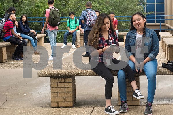 Sophomores Judith Rivera and Jennifer Lopez hang out outside during the first day of school at John Tyler High School in Tyler, Texas, on Monday, Aug. 28, 2017. (Chelsea Purgahn/Tyler Morning Telegraph)