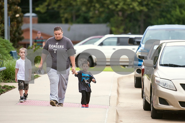 Korbin Hall, 5, Karlee Hall and Isaiah Garcia, 3, walk to the front door of the school during the first day of school at Orr Elementary School in Tyler, Texas, on Monday, Aug. 28, 2017. (Chelsea Purgahn/Tyler Morning Telegraph)