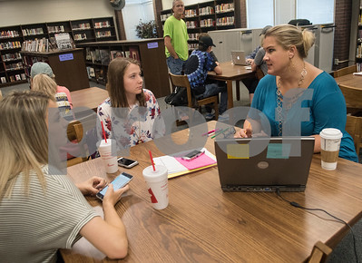 Juniors Kayleigh Fendrick and Katie Turner meet with counselor Shana Steele to register for classes on the first day of classes at Robert E. Lee High School in Tyler Monday Aug. 28, 2017.  (Sarah A. Miller/Tyler Morning Telegraph)