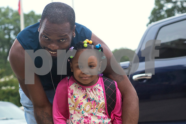 Brandon Hollins and Sherticia Dean, 5, pose for a photo during the first day of school at Orr Elementary School in Tyler, Texas, on Monday, Aug. 28, 2017. (Chelsea Purgahn/Tyler Morning Telegraph)