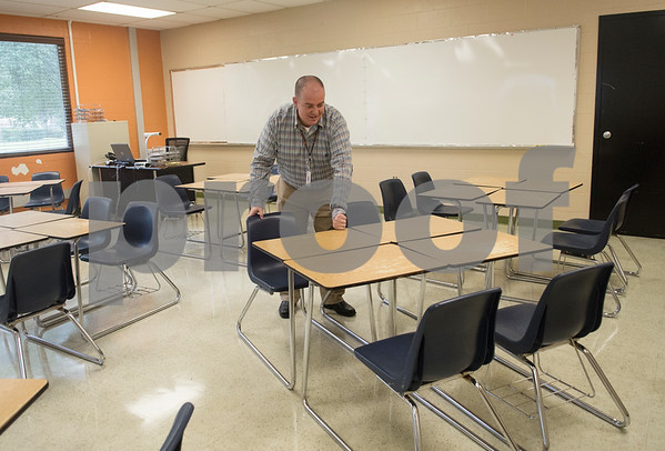 New teacher Jody Coward straightens desks and chair for his second period eighth grade math class on the first day of school at Hubbard Middle School in Tyler Monday Aug. 28, 2017.  (Sarah A. Miller/Tyler Morning Telegraph)