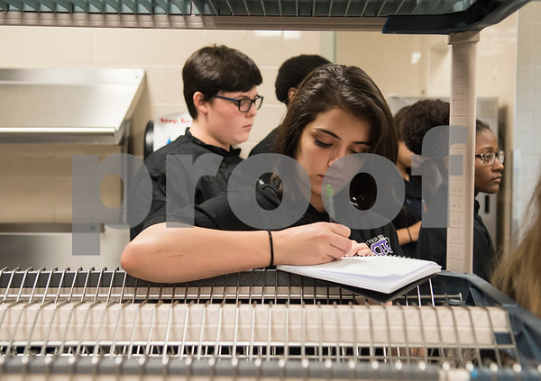 Student Natalie Kirkpatrick takes notes on dishwashing on the third day of school in the culinary arts program at the Tyler ISD Career and Technology Center Wednesday Aug. 30, 2017. Tyler ISD currently offers an introductory to culinary arts and a practicum of culinary arts course at the Career and Technology Center. Tyler may get its first college level culinary arts program when the Tyler Junior College board of trustees meet on Thursday.  (Sarah A. Miller/Tyler Morning Telegraph)