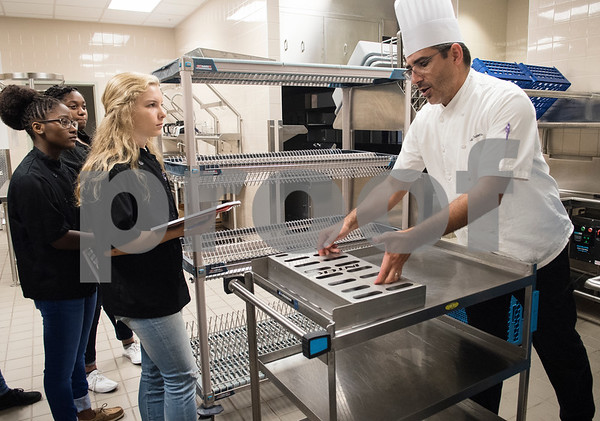 Joseph Guzzetta places a just washed tray onto a clean cart as he teaches his students about commercial kitchen cleaning procedures on the third day of school in the culinary arts program at the Tyler ISD Career and Technology Center Wednesday Aug. 30, 2017. Tyler ISD currently offers an introductory to culinary arts and a practicum of culinary arts course at the Career and Technology Center. Tyler may get its first college level culinary arts program when the Tyler Junior College board of trustees meet on Thursday.  (Sarah A. Miller/Tyler Morning Telegraph)