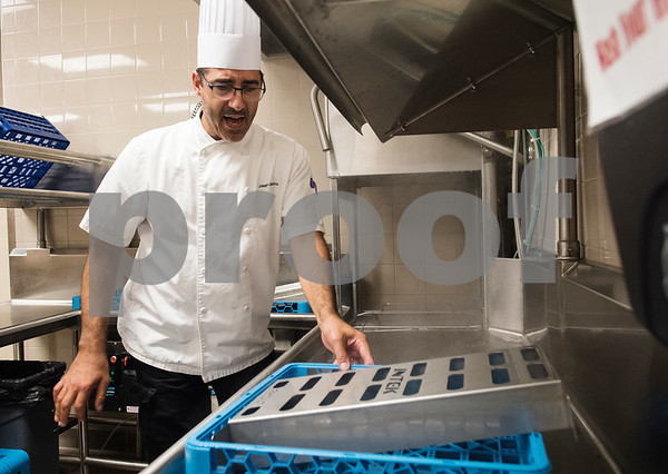 Joseph Guzzetta takes a tray out of the hi-temp dishwasher as he teaches his students about commercial kitchen cleaning procedures on the third day of school at the Tyler ISD Career and Technology Center Wednesday Aug. 30, 2017. Tyler ISD currently offers an introductory to culinary arts and a practicum of culinary arts course at the Career and Technology Center. Tyler may get its first college level culinary arts program when the Tyler Junior College board of trustees meet on Thursday.  (Sarah A. Miller/Tyler Morning Telegraph)