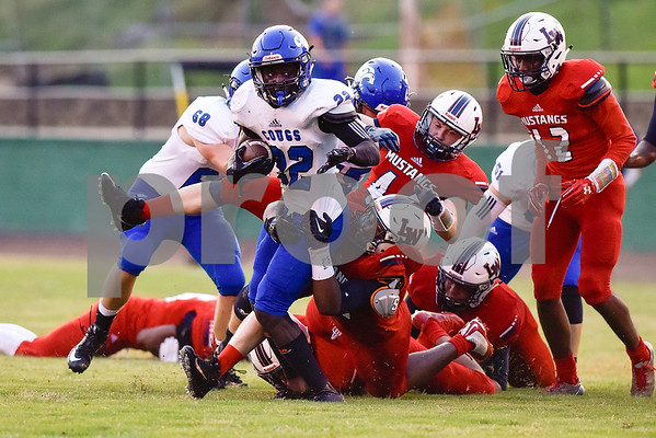 Grace Community School running back Uchenna Uduma (22) is tackled after breaking other tackles during a high school football game at McCallum Stadium at Bishop T.K. Gorman Catholic School in Tyler, Texas, on Thursday, Aug. 31, 2017. The Grace Community School Cougars beat the Waxahachie Life Mustangs 48-28. (Chelsea Purgahn/Tyler Morning Telegraph)
