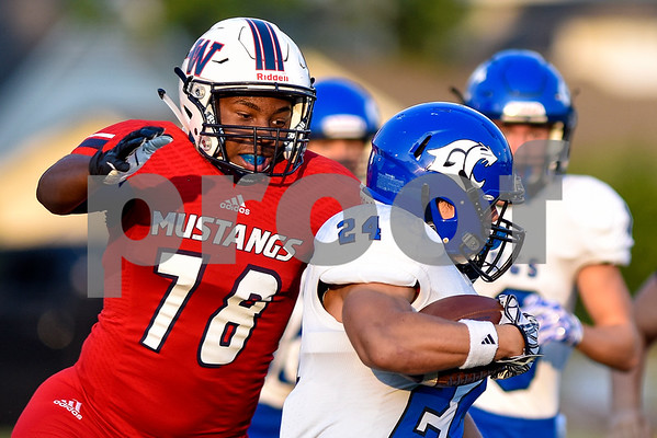 Waxahachie Life defensive lineman Kenneth Richardson (78) tackles Grace Community School wide receiver Alvin Skipworth (24) during a high school football game at McCallum Stadium at Bishop T.K. Gorman Catholic School in Tyler, Texas, on Thursday, Aug. 31, 2017. The Grace Community School Cougars beat the Waxahachie Life Mustangs 48-28. (Chelsea Purgahn/Tyler Morning Telegraph)