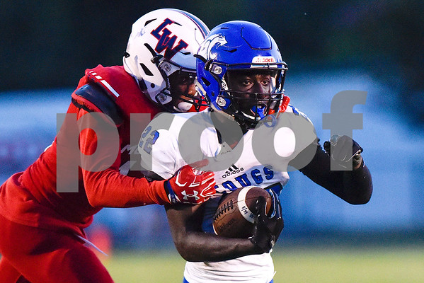 Grace Community School running back Uchenna Uduma (22) is tackled during a high school football game at McCallum Stadium at Bishop T.K. Gorman Catholic School in Tyler, Texas, on Thursday, Aug. 31, 2017. The Grace Community School Cougars beat the Waxahachie Life Mustangs 48-28. (Chelsea Purgahn/Tyler Morning Telegraph)
