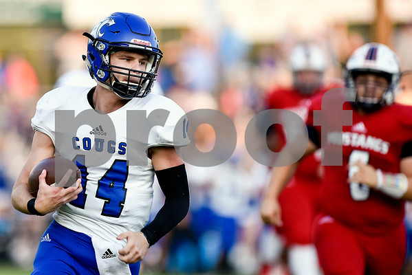 Grace Community School quarterback Braydon Stone (14) runs the ball during a high school football game at McCallum Stadium at Bishop T.K. Gorman Catholic School in Tyler, Texas, on Thursday, Aug. 31, 2017. (Chelsea Purgahn/Tyler Morning Telegraph)
