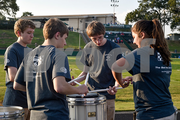 Grace Community School band members, from left to right, Jacob Craver, Jason Reis, Christopher Abeldt and Macy Adams play drums before a high school football game at McCallum Stadium at Bishop T.K. Gorman Catholic School in Tyler, Texas, on Thursday, Aug. 31, 2017.  (Chelsea Purgahn/Tyler Morning Telegraph)