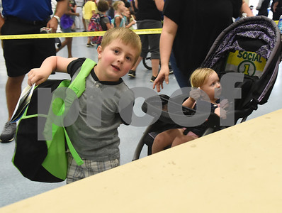 Korben Smith, 5, receives a free backpack for kindergarten at the annual event called School is Cool. School is Cool provides free backpacks and school supplies to children as well as free haircuts, immunizations, dental and eye exams.   (Sarah A. Miller/Tyler Morning Telegraph)