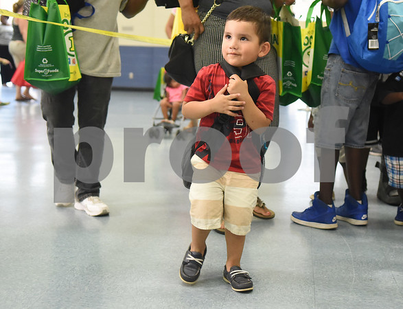 Jaime Pineda, 5, gets a free backpack at the annual event called School is Cool Thursday August 4, 2016 at Harvey Convention Center. School is Cool provides free backpacks and school supplies to children as well as free haircuts, immunizations, dental and eye exams.   (Sarah A. Miller/Tyler Morning Telegraph)