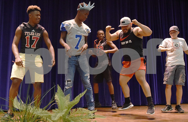Josue Perez, second from right, leads a Zumba dance at the School is Cool event Thursday August 4, 2016 at Harvey Convention Center. School is Cool provides free backpacks and school supplies to children as well as free haircuts, immunizations, dental and eye exams.   (Sarah A. Miller/Tyler Morning Telegraph)