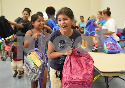 Annie Pineda, 10, gets a free backpack at the annual event called School is Cool Thursday August 4, 2016 at Harvey Convention Center. School is Cool provides free backpacks and school supplies to children as well as free haircuts, immunizations, dental and eye exams.   (Sarah A. Miller/Tyler Morning Telegraph)