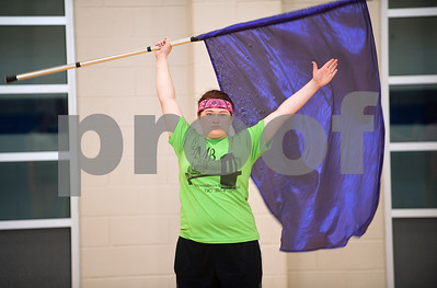 Brownsboro Military Band Auxiliary color guard member senior Mary Whittle holds her flag inside the Brownsboro Elementary School gymnasium Thursday. The marching band, including its drumlin, color guard and majorettes have been participating in band camp this week to prepare for their upcoming football season performances. The band will perform at Brownsboro's first football game at Crandall Aug. 28 and the first home game is Sept. 11.   (photo by Sarah A. Miller/Tyler Morning Telegraph)