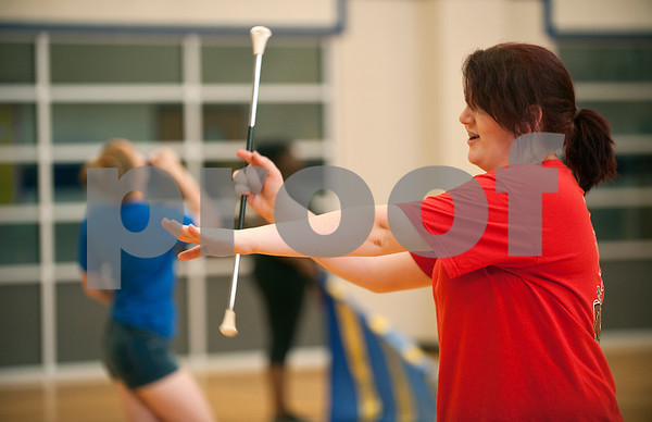 Brownsboro Military Band Auxiliary color guard majorette sergeant senior Kaitlyn Smith twirls her baton inside the Brownsboro Elementary School gymnasium Thursday. The marching band, including its drumlin, color guard and majorettes have been participating in band camp this week to prepare for their upcoming football season performances. The band will perform at Brownsboro's first football game at Crandall Aug. 28 and the first home game is Sept. 11.   (photo by Sarah A. Miller/Tyler Morning Telegraph)