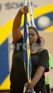 Brownsboro Military Band Auxiliary color guard member junior Bri Earl holds her flag inside the Brownsboro Elementary School gymnasium Thursday. The marching band, including its drumlin, color guard and majorettes have been participating in band camp this week to prepare for their upcoming football season performances. The band will perform at Brownsboro's first football game at Crandall Aug. 28 and the first home game is Sept. 11.   (photo by Sarah A. Miller/Tyler Morning Telegraph)