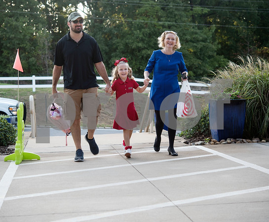 Jason Galusha and Carey Christie hold hands with kindergartner Aubrey Galusha, 5, as she arrives for the first day of school at All Saints Episcopal School on Thursday Aug. 16, 2018.   (Sarah A. Miller/Tyler Morning Telegraph)