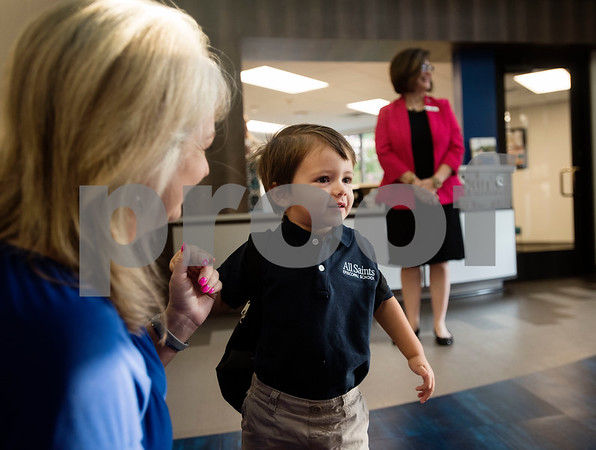 Jill Smith, Director of Early Learning, greets Pre-K3 student Nathaniel Juarez, 3, on the first day of school at All Saints Episcopal School on Thursday Aug. 16, 2018.   (Sarah A. Miller/Tyler Morning Telegraph)
