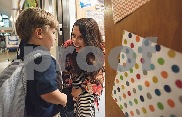 Pre-K4 teacher Jennifer Stanley greets student Thomas Woods, 4, at the classroom door on the first day of school at All Saints Episcopal School on Thursday Aug. 16, 2018.   (Sarah A. Miller/Tyler Morning Telegraph)
