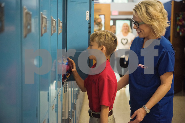 Fourth grader Tate Scully and his mother Elizabeth Scully are surprised to find his missing soccer ball in his locker on the first day of school at All Saints Episcopal School on Thursday Aug. 16, 2018. Scully lost his soccer ball during a summer camp.  (Sarah A. Miller/Tyler Morning Telegraph)