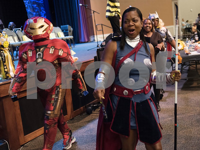 Veronica Gilbert of Ingersoll Rand/Trane wears an Iron Man costume and LaVera Robinson dresses as Valkyrie during the Literacy Council of Tyler's 26th annual Corporate Spelling Bee at the Green Acres CrossWalk Center in Tyler Tuesday Aug. 8, 2017. Teams from Tyler area businesses dress in costumes and compete in the spelling bee as a fundraiser for the Literacy Council of Tyler, an organization that works to eliminate illiteracy through educational services.  (Sarah A. Miller/Tyler Morning Telegraph)
