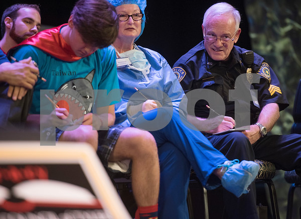 Tyler Junior College's Mike Pierce, far right, jots down the spelling of a word during the Literacy Council of Tyler's 26th annual Corporate Spelling Bee at the Green Acres CrossWalk Center in Tyler Tuesday Aug. 8, 2017. Teams from Tyler area businesses dress in costumes and compete in the spelling bee as a fundraiser for the Literacy Council of Tyler, an organization that works to eliminate illiteracy through educational services.  (Sarah A. Miller/Tyler Morning Telegraph)
