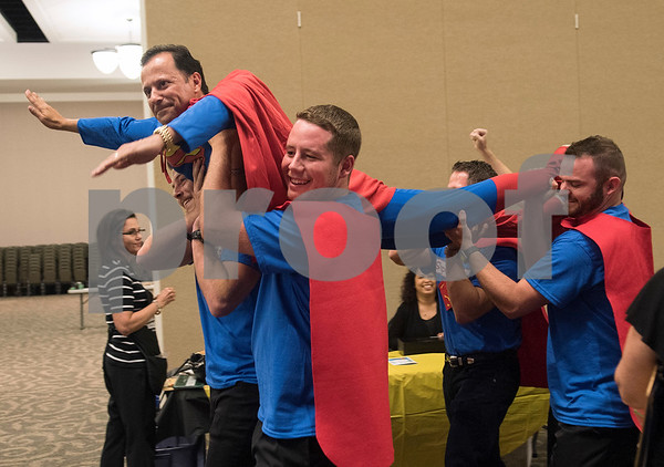 Walter Wilhelmi of Prothro Wilhelmi and Company is carries in as Superman during the Literacy Council of Tyler's 26th annual Corporate Spelling Bee at the Green Acres CrossWalk Center in Tyler Tuesday Aug. 8, 2017. Teams from Tyler area businesses dress in costumes and compete in the spelling bee as a fundraiser for the Literacy Council of Tyler, an organization that works to eliminate illiteracy through educational services.  (Sarah A. Miller/Tyler Morning Telegraph)