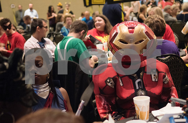Veronica Gilbert of Ingersoll Rand/Trane wears an Iron Man costume during the Literacy Council of Tyler's 26th annual Corporate Spelling Bee at the Green Acres CrossWalk Center in Tyler Tuesday Aug. 8, 2017. Teams from Tyler area businesses dress in costumes and compete in the spelling bee as a fundraiser for the Literacy Council of Tyler, an organization that works to eliminate illiteracy through educational services.  (Sarah A. Miller/Tyler Morning Telegraph)