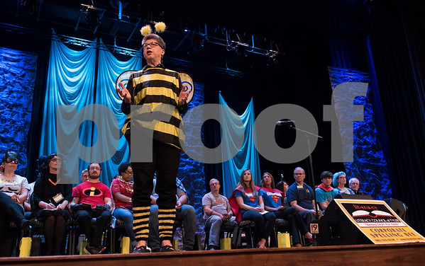 Nancy Crawford, executive director of the Literacy Council of Tyler's, announces the start of their 26th annual Corporate Spelling Bee at the Green Acres CrossWalk Center in Tyler Tuesday Aug. 8, 2017. Teams from Tyler area businesses dress in costumes and compete in the spelling bee as a fundraiser for the Literacy Council of Tyler, an organization that works to eliminate illiteracy through educational services.  (Sarah A. Miller/Tyler Morning Telegraph)