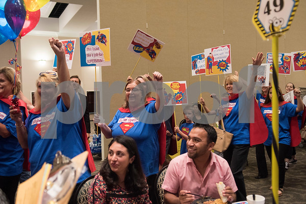 Members of team Prothro Wilhelmi and Company arrive in Superman theme during the Literacy Council of Tyler's 26th annual Corporate Spelling Bee at the Green Acres CrossWalk Center in Tyler Tuesday Aug. 8, 2017. Teams from Tyler area businesses dress in costumes and compete in the spelling bee as a fundraiser for the Literacy Council of Tyler, an organization that works to eliminate illiteracy through educational services.  (Sarah A. Miller/Tyler Morning Telegraph)