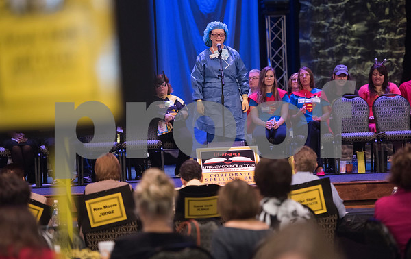 Brenda Korich of Tyler Junior College spells a word during the Literacy Council of Tyler's 26th annual Corporate Spelling Bee at the Green Acres CrossWalk Center in Tyler Tuesday Aug. 8, 2017. Teams from Tyler area businesses dress in costumes and compete in the spelling bee as a fundraiser for the Literacy Council of Tyler, an organization that works to eliminate illiteracy through educational services.  (Sarah A. Miller/Tyler Morning Telegraph)