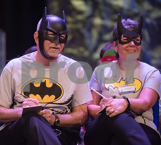 Tyler ISD's Mike Pope and Mary Russell listen for their word to spell during the Literacy Council of Tyler's 26th annual Corporate Spelling Bee at the Green Acres CrossWalk Center in Tyler Tuesday Aug. 8, 2017. Teams from Tyler area businesses dress in costumes and compete in the spelling bee as a fundraiser for the Literacy Council of Tyler, an organization that works to eliminate illiteracy through educational services.  (Sarah A. Miller/Tyler Morning Telegraph)