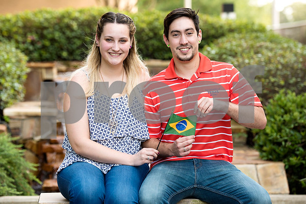 Linda Lopes Evangelista and Joao Pedro Zorreia Kuster Maia, both of Brazil, pose for a portrait with their country's flag the University of Texas at Tyler in Tyler, Texas, on Monday, Sept. 11, 2017. There are more than 300 international students from 51 countries currently represented at UT Tyler. (Chelsea Purgahn/Tyler Morning Telegraph)