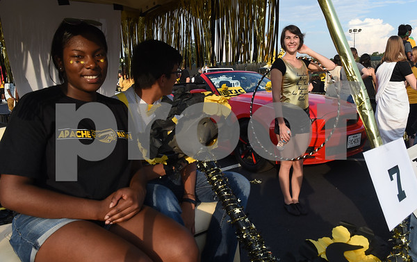 La'Randall Carter, Carlos Salazar and Jessica Kimbell wait for the start of the Homecoming parade Thursday evening Sept. 15, 2016 on the campus of Tyler Junior College. TJC is celebrating its 90th year.   (Sarah A. Miller/Tyler Morning Telegraph)