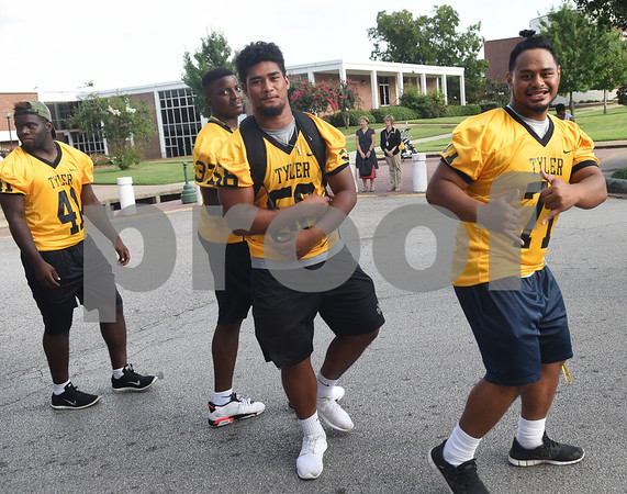 Football players walk in the Homecoming parade Thursday evening Sept. 15, 2016 on the campus of Tyler Junior College. TJC is celebrating its 90th year.   (Sarah A. Miller/Tyler Morning Telegraph)