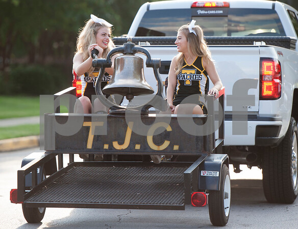 TJC cheerleaders Amber Bishop and Taylor Montgomery ring the Apache bell during the Homecoming parade Thursday evening Sept. 15, 2016 on the campus of Tyler Junior College. TJC is celebrating its 90th year.   (Sarah A. Miller/Tyler Morning Telegraph)