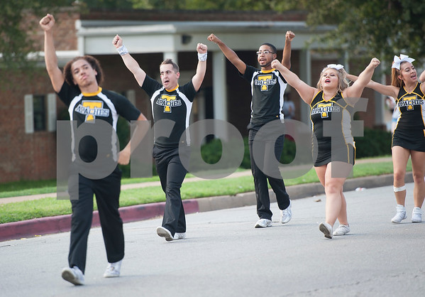 The cheerleading team performs during the Homecoming parade Thursday evening Sept. 15, 2016 on the campus of Tyler Junior College. TJC is celebrating its 90th year.   (Sarah A. Miller/Tyler Morning Telegraph)