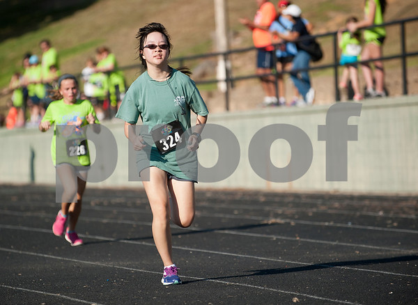 Iris Wang, 15, runs to the finish line at the 30th annual St. Gregory Fun Run held at the Bishop Thomas K. Gorman campus in Tyler Saturday Sept.  19, 2015. The event is a fundraiser for St. Gregory Cathedral School, Tyler's oldest private, Christian elementary school.  (Sarah A. Miller/Tyler Morning Telegraph)
