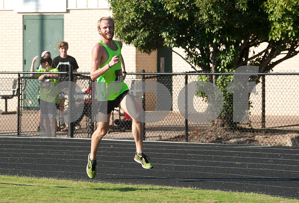 Alex Wilson comes in first place at the 30th annual St. Gregory Fun Run held at the Bishop Thomas K. Gorman campus in Tyler Saturday Sept.  19, 2015. The event is a fundraiser for St. Gregory Cathedral School, Tyler's oldest private, Christian elementary school.  (Sarah A. Miller/Tyler Morning Telegraph)